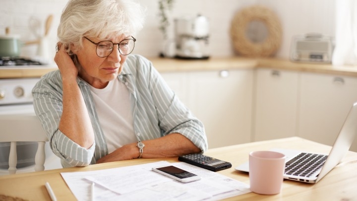 older woman looking at finances