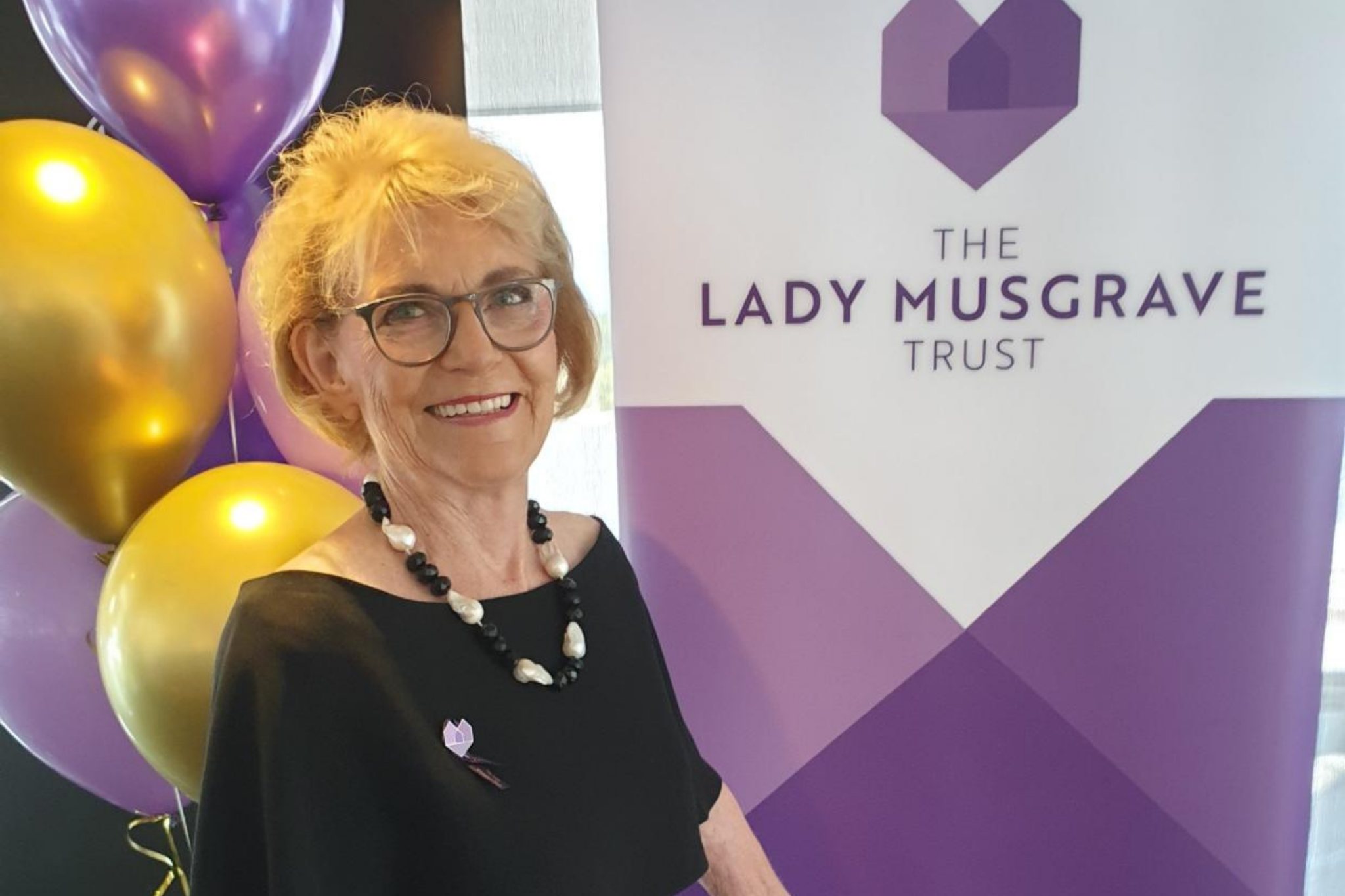 Patricia McCormack in front of a The Lady Musgrave Trust banner